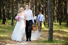 Bride and groom having a walk Stock Photography