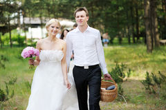 Bride and groom having a walk Royalty Free Stock Image