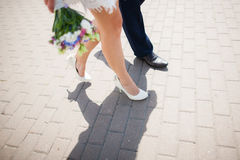 Bride and groom having walk outside on spring or summer warm day Stock Image