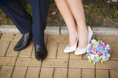 Bride and groom having walk outside on spring or summer warm day Stock Images
