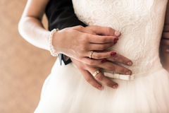 The bride and groom held hands Royalty Free Stock Image