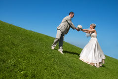 Bride and groom on the hill Royalty Free Stock Photo