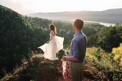 Bride and groom on the hill Royalty Free Stock Images