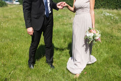 Bride and groom hold the hand Stock Photo
