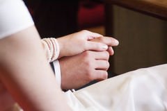 Bride and groom hold hands. Bride and groom holding hands stock photos