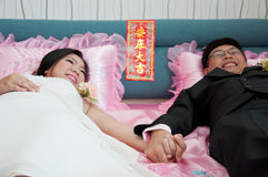 Bride and groom hold their hand Stock Images