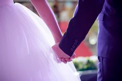 Bride and groom hold their hand. In the wedding day Royalty Free Stock Image