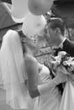Bride and groom are holding balloons Stock Image