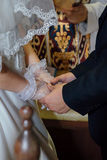 Bride and groom holding both hands. Royalty Free Stock Photography