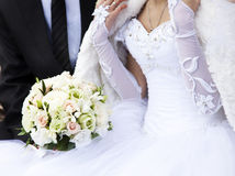 Bride and groom holding bouquet Royalty Free Stock Photography