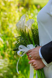 Bride and groom holding a bouquet of Kala Stock Photo