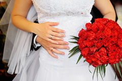 Bride and groom holding bridal bouquet close up Stock Photography
