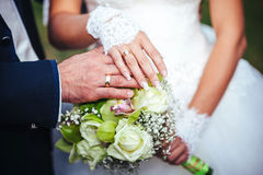 Bride and groom holding bridal bouquet close up Royalty Free Stock Images