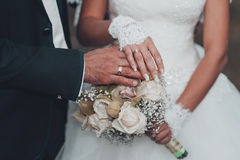 Bride and groom holding bridal bouquet close up Royalty Free Stock Photos
