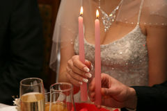 Bride and groom are holding candles Royalty Free Stock Photo