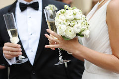 Bride and groom holding champagne glasses Stock Photos