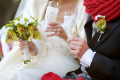 Bride and groom holding champagne glasses Stock Photo