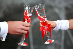 Bride and groom holding champagne glasses. Champagne Toast . Wedding glasses in their hands Royalty Free Stock Photos