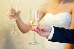 Glasses in hands close-up. holiday, wedding stock photos