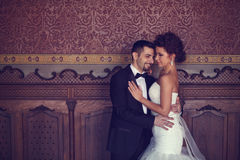 Bride and groom holding each other Royalty Free Stock Images