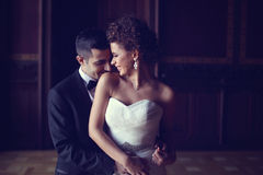 Bride and groom holding each other.  Stock Photos