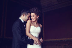 Bride and groom holding each other.  Royalty Free Stock Photos