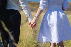 Bride and groom holding each other hands Royalty Free Stock Photography