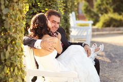 Bride and groom holding each other. Lovely day Stock Image