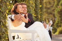 Bride and groom holding each other. Lovely day Stock Photo