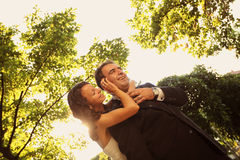 Bride and groom holding each other. Lovely day Royalty Free Stock Photos