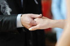 Bride and groom holding each other's hands Royalty Free Stock Photos