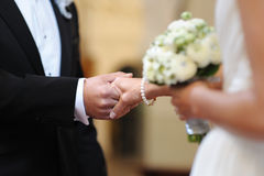 Bride and groom holding each other's hands Stock Photography
