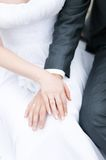 Bride and groom holding each others hands Royalty Free Stock Images