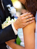 Bride and groom holding flower outdoor. Stock Photo