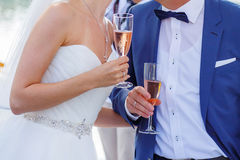 Bride and groom holding a glass of champagne Stock Photo