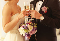 Bride and groom holding glasses of champagne Stock Images