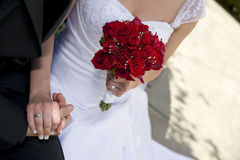 Bride & Groom Holding Hands Royalty Free Stock Photo
