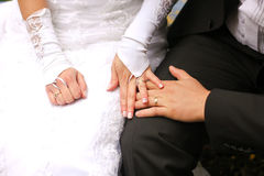 Bride and groom holding hands. Detail of bride and groom holding each other's hands Royalty Free Stock Photography