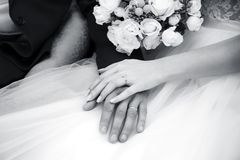 Bride and groom holding hands. Wedding. Black and white stock photo