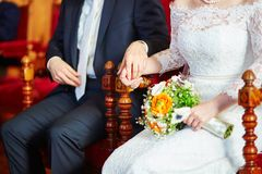 Bride and groom holding hands during the ceremony Royalty Free Stock Photography