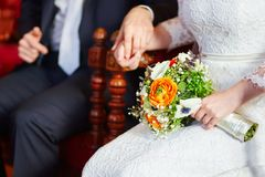 Bride and groom holding hands during the ceremony Stock Images