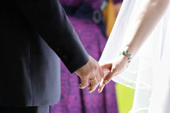 Bride and groom holding hands Stock Photos