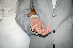 Bride and groom holding hands. Close up of bride and groom holding hands at wedding ceremony Royalty Free Stock Photography