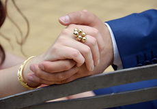 Bride and groom holding hands after they got married Stock Image