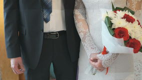 The bride and groom holding hands stock footage