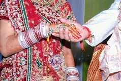 Indian bride and groom holding hands Royalty Free Stock Photography