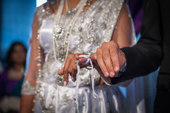 Bride and groom holding hands during the indian wedding ceremony Royalty Free Stock Images