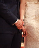 Bride and groom holding hands indoors Royalty Free Stock Photo