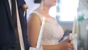Bride and Groom Holding in Hands Lighted Candles stock footage