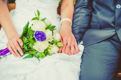 Bride and groom holding hands. stock photos